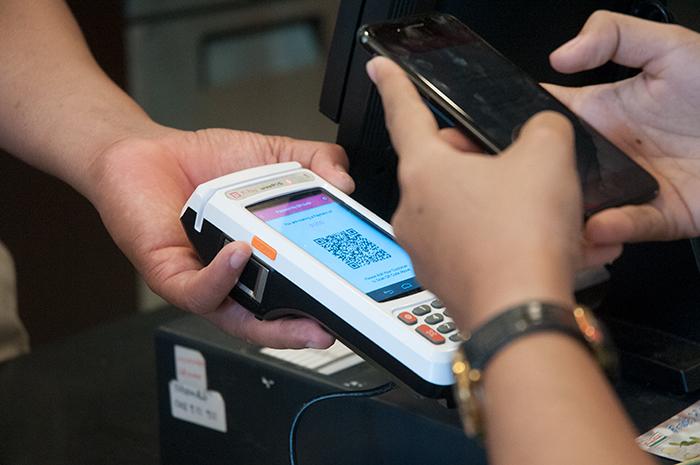 Scan QR Code on Merchant's device